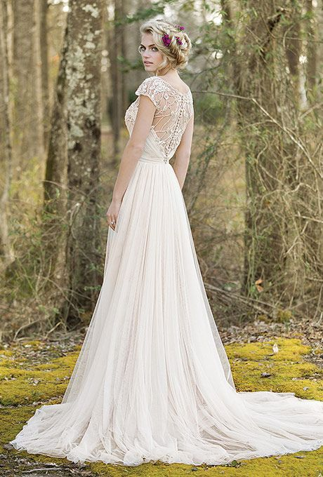 Brides: Lillian West. See More Details from Lillian WestHand beaded details adorn this English net slim A-line gown with an illusion beaded back, Jersey lining, and chapel length train.