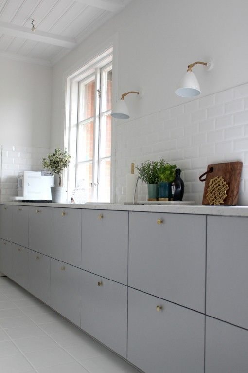"Grey kitchen ""Veddinge"" with brass door knobs. From IKEA."