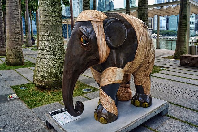 """""""Damaged Dumbo"""" at the Elephant Parade in Singapore - photo by Choo Yut Shing, via Flickr;  The artwork on a life-size baby elephant statue by Renato L. Barja, Jr., is on display at Marina Bay Sands Event Plaza."""
