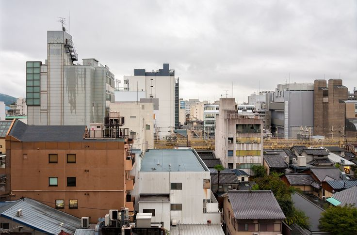 Kyoto cityscape on a rainy day - This photo is published under Creative Commons Attribution-NonCommercial 3.0 license.