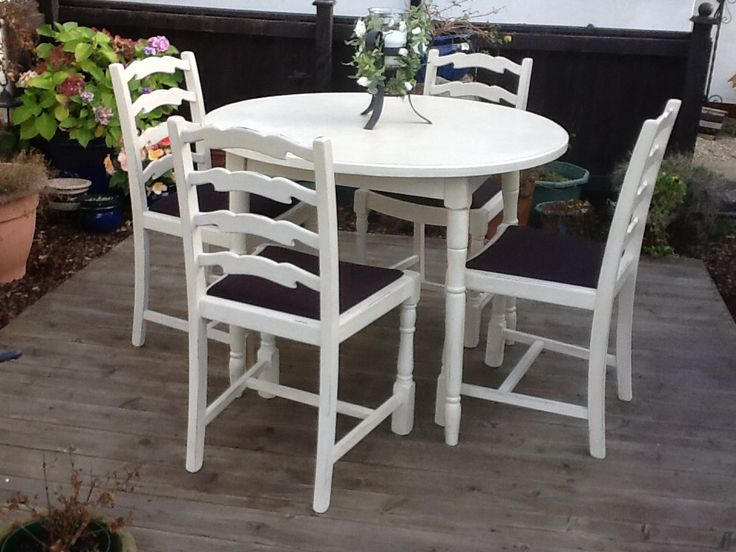 Up cycled dinning table and chairs painted in Annie Sloan Old Orche and waxed for protection, and reupholstered in black fabric.