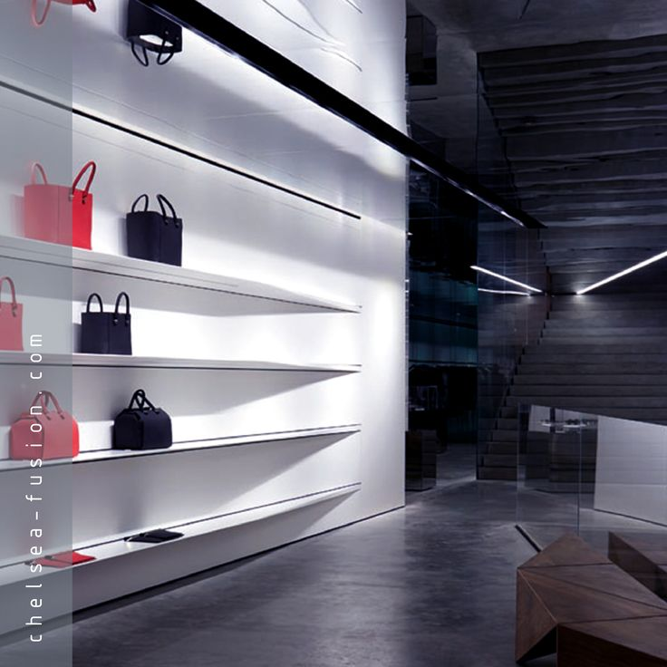 Diamond Mirror architectural glass is an impact resistant safety mirror, enabling designers to create large uniform reflective surfaces, including ceilings, wall and lift cladding and partition screens. Image: Diamond Mirror at the Farshid Moussavi designed Victoria Beckham retail space. #kilnformedglass #architecturalglass #decorativeglass #frostedglass #etchedglass #mirrorglass