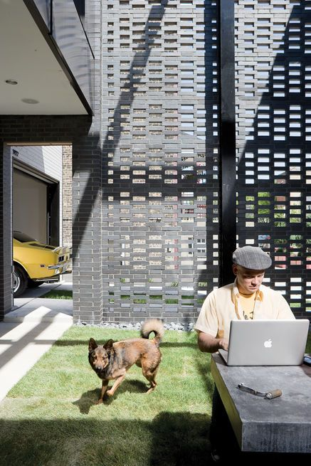 David Hernandez and Jack enjoy the house's walled garden.  Photo by: Gregg Segal