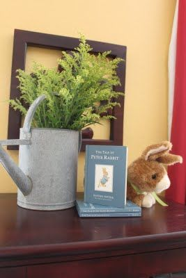 Put flowers in a metal watering can for decor for a Peter Rabbit themed party. #flowers #watering #can #decor #baby #shower #peter #rabbit #party #event