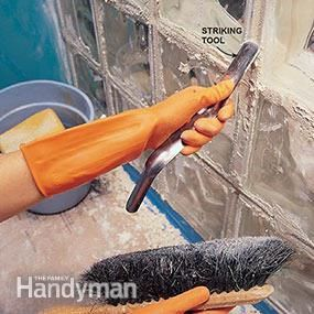 Clean the joints of the glass block installation with a striking tool.