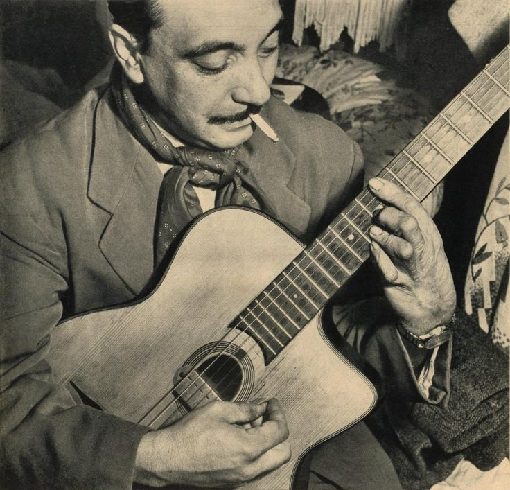 "Jean-Baptiste ""Django"" Reinhardt was born in Belgium Jan. 23, 1910.  Died May 6, 1953. His left hand was damaged when his gypsy wagon caught fire. Celluloid flowers ignited from an overturned candle.  He was able to overcome his handicap and become one of the greatest jazz guitarists of all time!"