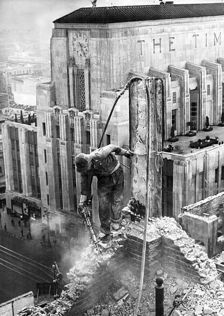 I love the drama inherent in this photograph. The new and current Los Angeles Times building rises behind a worker demolishing the paper's previous home in 1937. And not only is that construction worker up pretty high, he seems to be untethered as he jackhammers away at the brickwork he's standing on.