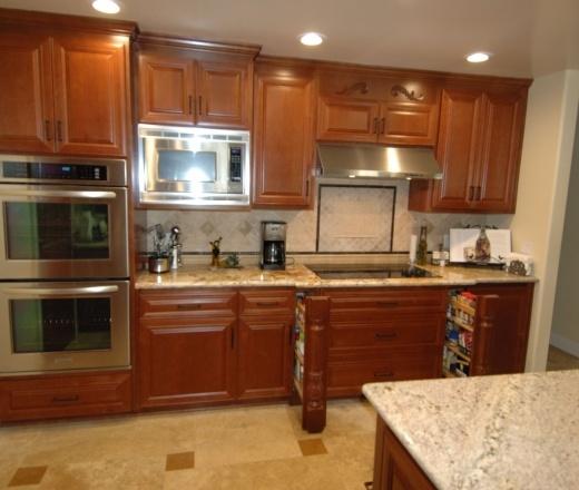 Traditional L-shaped Pale Yellow kitchen, oak cabinets ...