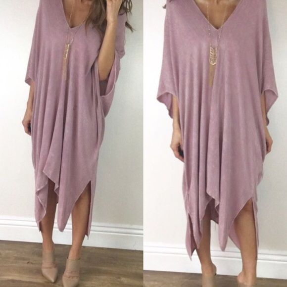 • Last Item • Bohemian Mauve Dress L A stunning flowy bohemian chic dress that is effortless & beautiful. In a gorgeous mauve color. Fabric is an incredibly soft gauze and lightweight. Fully lined. Asseymtric hemline with a V neckline. This will be a standout piece in your wardrobe. Size M measures 30 inches across the chest 36 at shortest 47 inch longest. 100% Rayon. Sizing is flexible on this one. Boutique Other