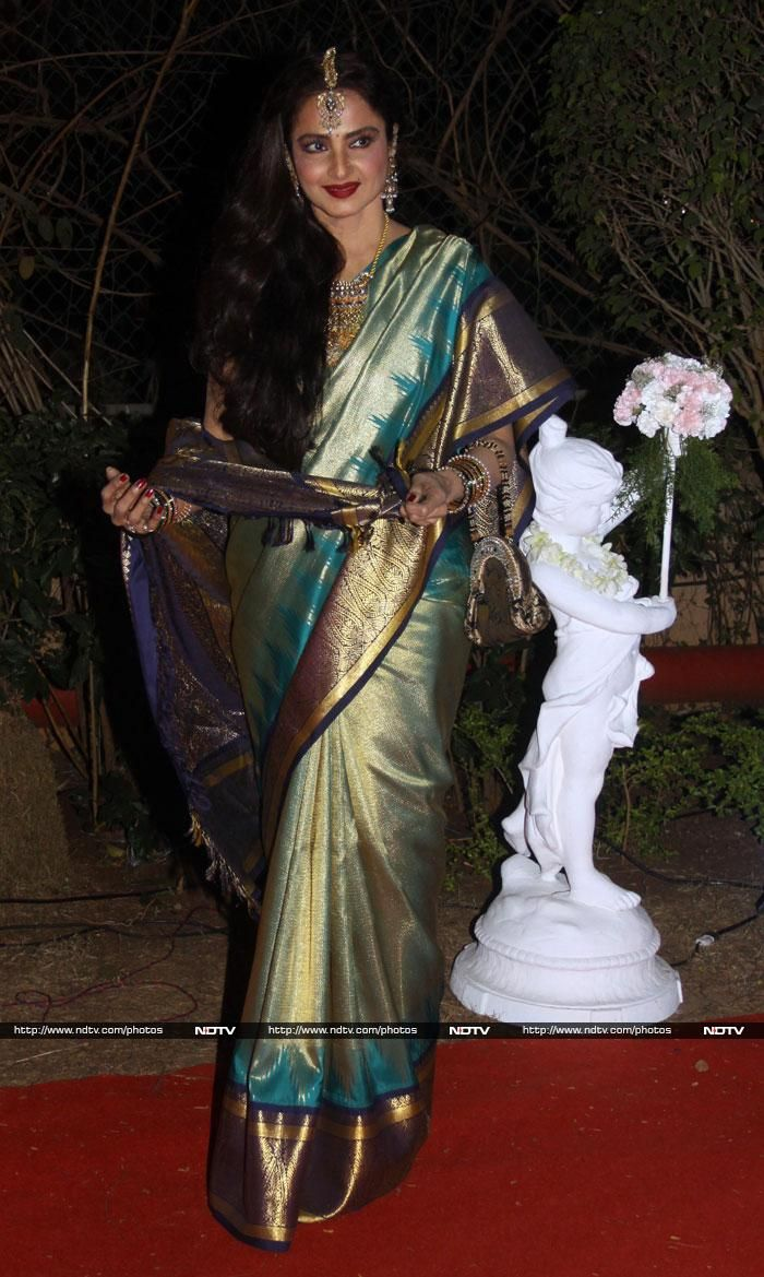 Rekha, who was dripping in jewels, looked beautiful in a rich silk Kanjeevaram sari.