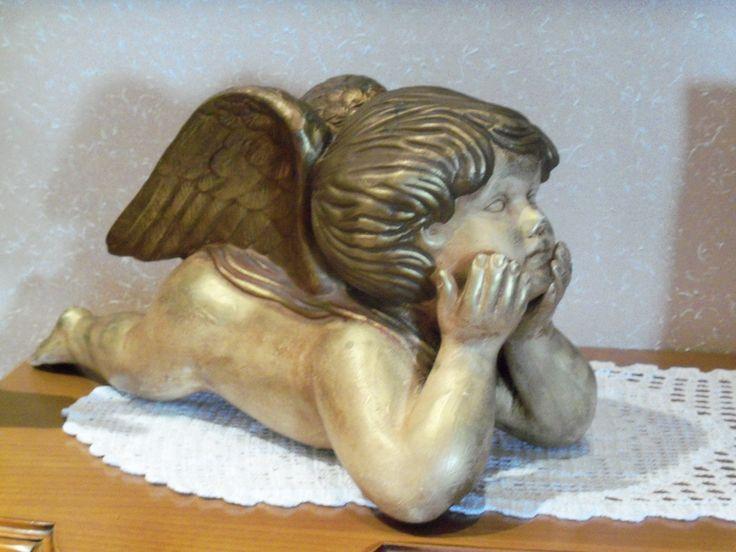 Es una figura de yeso esta pintada con pintura dorada y - Pintura dorada para madera ...