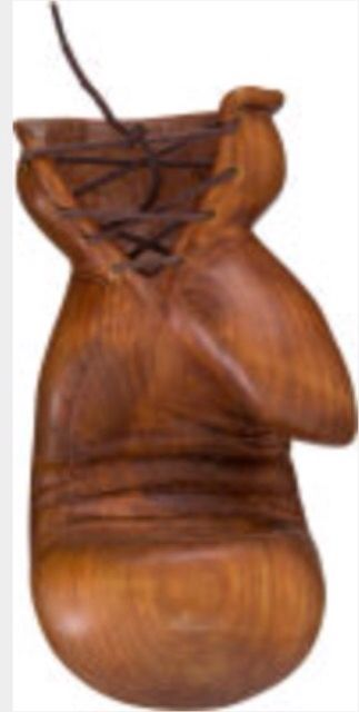 http://sports.ha.com/itm/boxing/1990-s-muhammad-ali-signed-hand-carved-wooden-boxing-glove/a/7120-82605.s