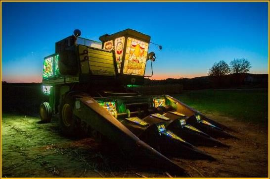Ruminant (The Grand Masticator) – a harvesting combine clad in 34 backlit, agriculturally-themed stained glass panels. Reedsburg, WI
