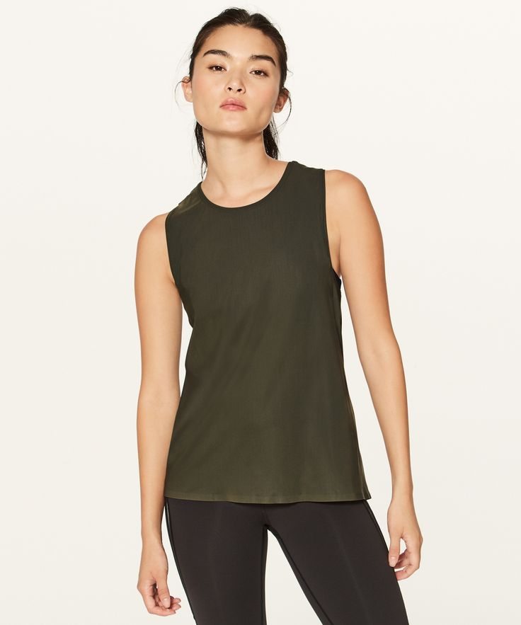 Slip on this lightweight,  high-coverage tank as your  first layer when you gear up  for outdoor runs. The smooth  fabric, wide straps, and  bonded seams make your  shoulders feel comfortable on  your run—even with a running  backpack in tow.
