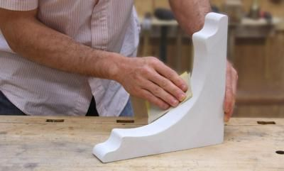 [Click for full-size] Learn how to make your own decorative corbels that double as either shelf or countertop supports.