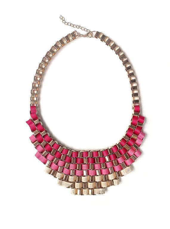 Pink statement necklace with an ombre gradient made of interweaving ribbons of different shades of pink.