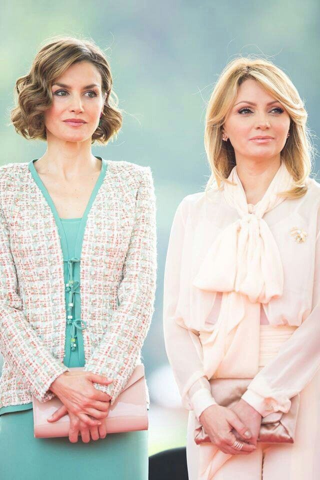 Spanish Queen Letizia and Mexico's first lady Angelica Rivera, stand on a staging area as their husbands review an honor guard during a welcoming ceremony at the Campo Marte military field in Mexico City on June 29, 2015.