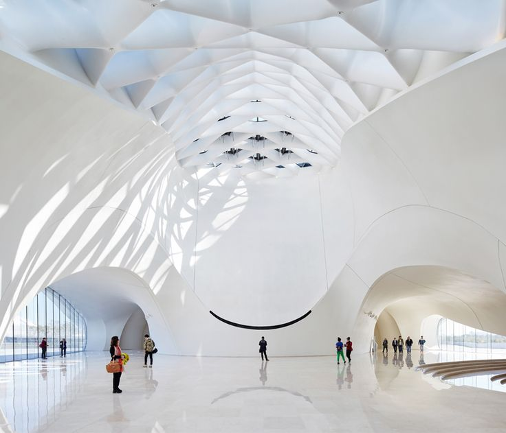 MAD architects' poetic and fluid-formed harbin opera house opens in china