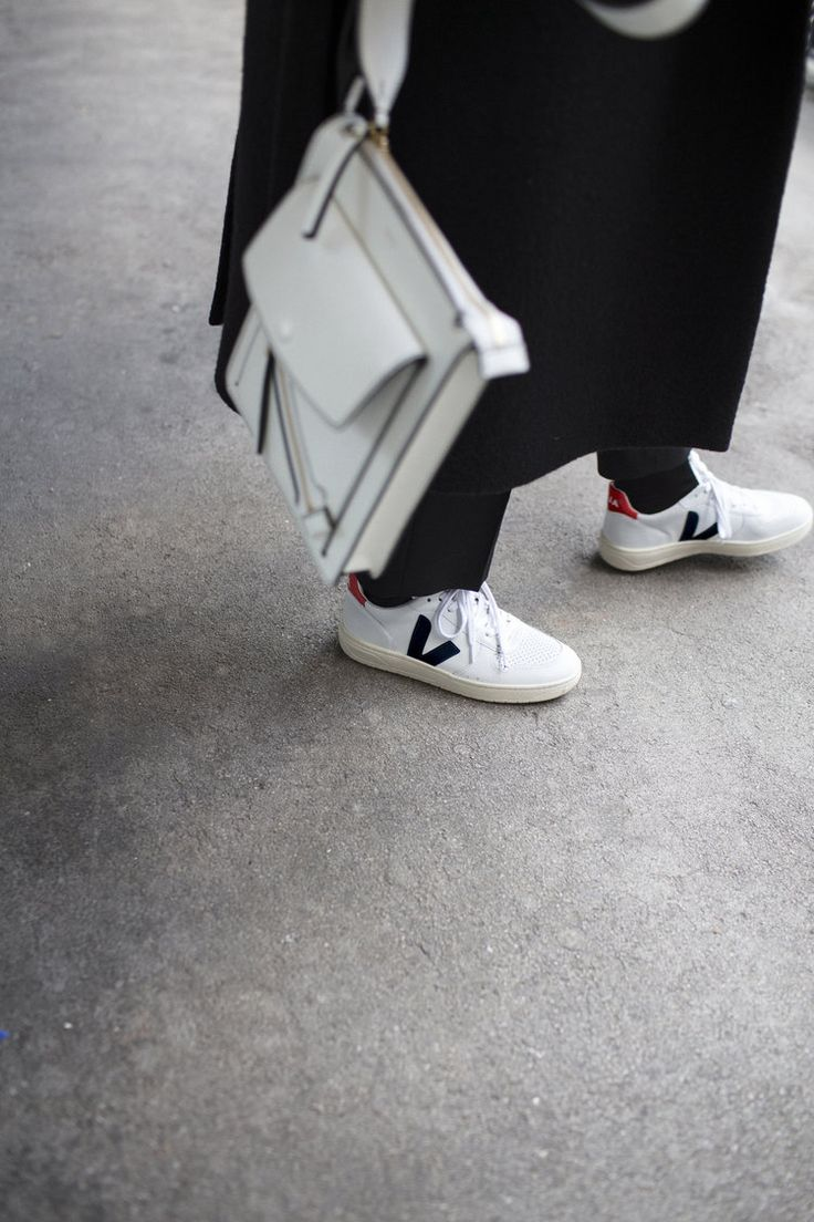 Coat: COS / Roll Neck: COS / Trousers: Acne / Trainers: Veja / Bag: Joseph /