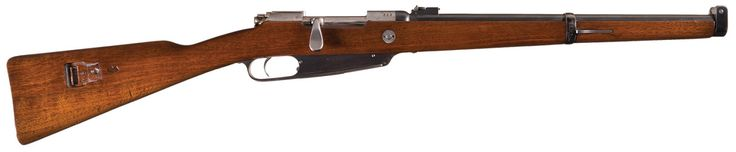 'Commission' Karabiner 88 rifle    Manufactured by Schilling in Suhl, Germany c.1892 - serial number 4625e.  M/88 five round en-bloc clip, bolt action.  Developed in answer to the French Lebel rifle, the Model 1888 copies its barrel but adds to it a Mannlicher receiver with a few Mauser features. Germany settled a lawsuit with Steyr-Mannlicher over the design by making them one of the manufacturer, leading Steyr to make rifles for both the French and the German in the same decade.