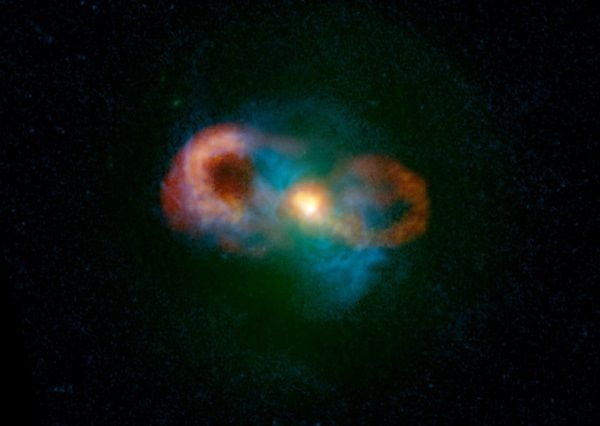 Teacup Galaxy (J1430+1339) : Transitional Galaxy - In this VLA (Very Large Array) composite : green/starlight - blues/gas - reds & yellows/radio emissions. A supermassive black hole at the center of the Teacup galaxy is launching powerful jets that are accelerating the gas in the host galaxy. This process destroys or removes star-forming material, changing this galaxy from a star-forming galaxy into an elliptical galaxy with little or no gas