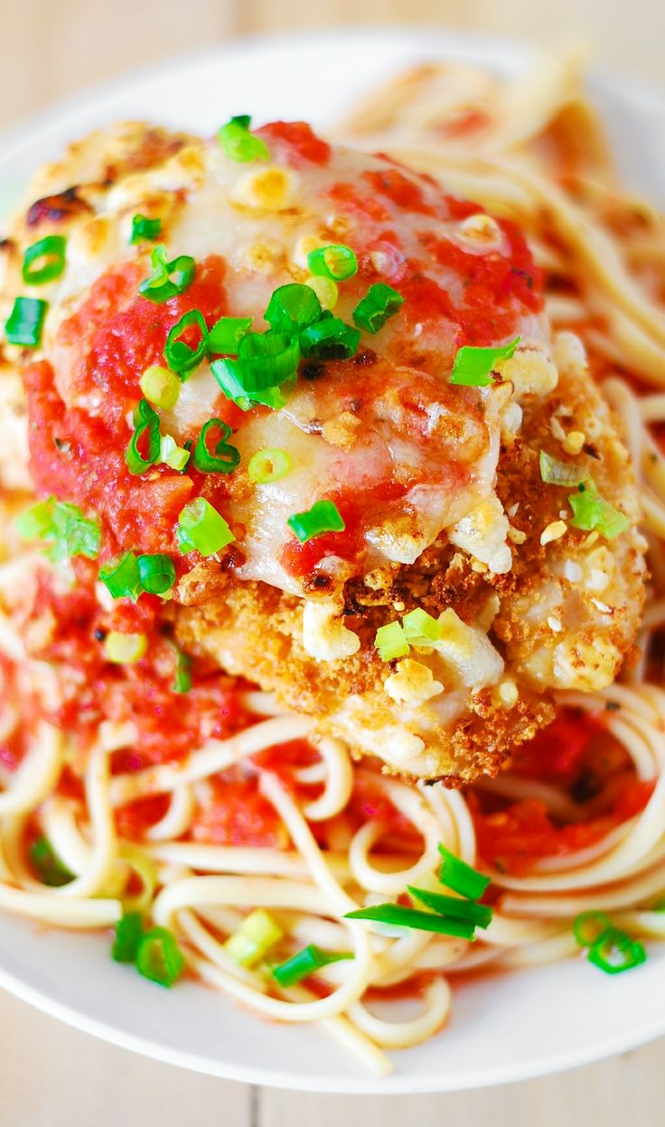Chicken Parmesan with a side of pasta and garlic tomato sauce. Chicken ...