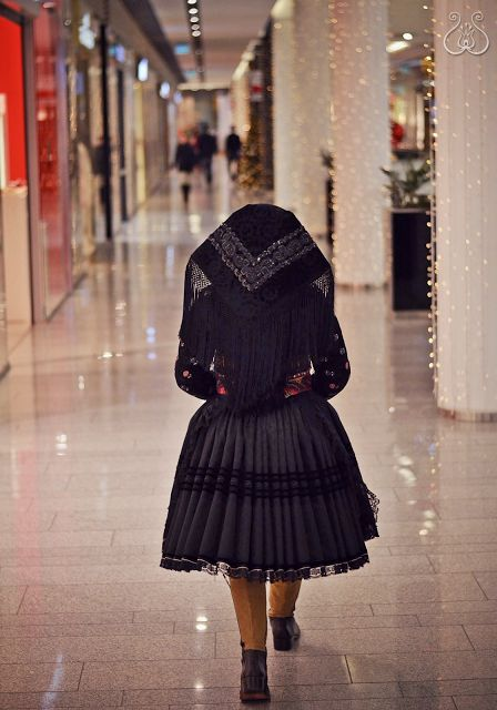 The (sad) contrast of traditional slovak folk costume and a shopping mall in the capital city of Slovakia.