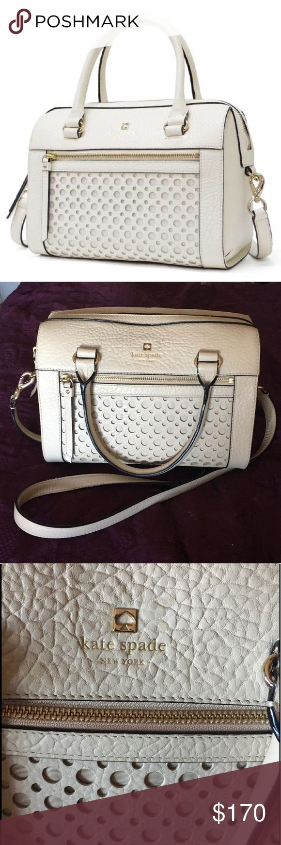 Kate Spade Perri Lane bubble Delaney shoulder bag Kate Spade Perri Lane Delaney two way shoulder bag in the color bone which is an off white color. Bubble cut out design on the front with a zipped pocket. Pebbled leather with gold tone hardware and Kate spade logo on front. There is a slight scuff mark to the right of the hardware on the front. Long straps are removable, can be worn on the shoulder or as a cross body, it also has the shorter handles so it can be worn on the forearm. Lined…