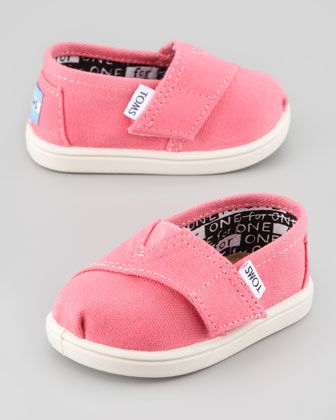 Classic Canvas Slip-On, Pink, Tiny  by TOMS at Neiman Marcus. I just really feel like Adelyn needs these.