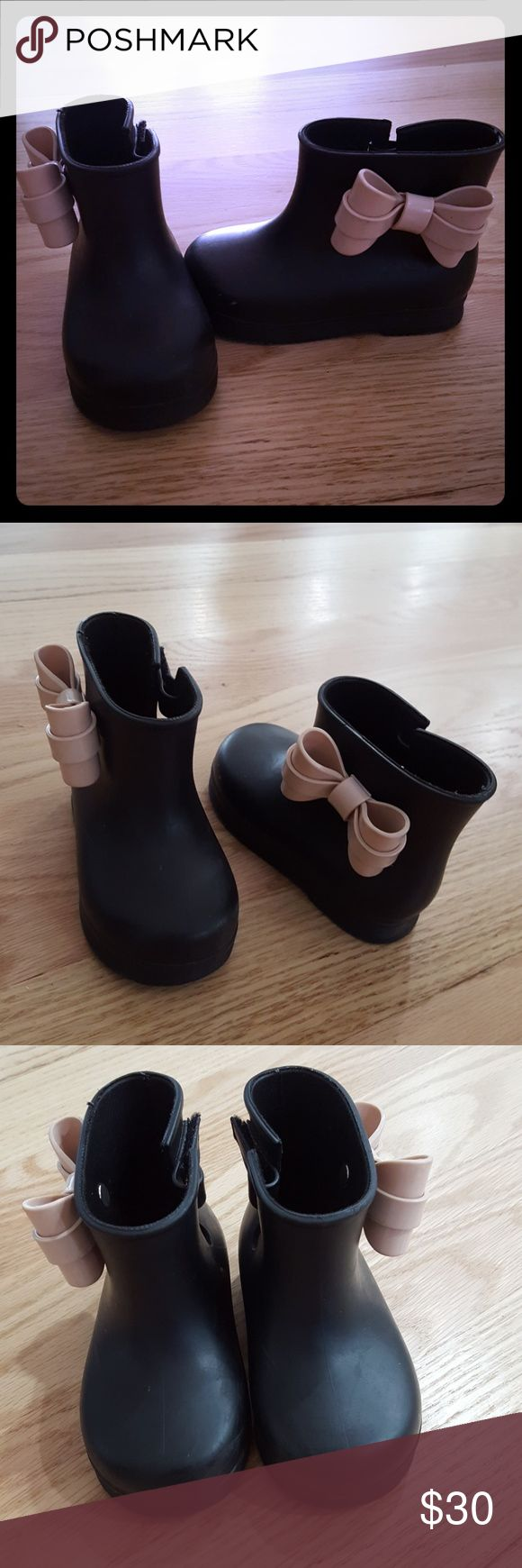 Mini melissa boots with pink bow size 7/8 Mini Melissa black boots with pink bows on side, very comfortable and great for all season. My daughter loves it but outgrow it already. In great condition! Mini Melissa Shoes Ankle Boots & Booties