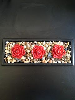 Easy Home Decor.  I have a similar box with stones and circle tea light holder.  I love the idea of these flower candles.