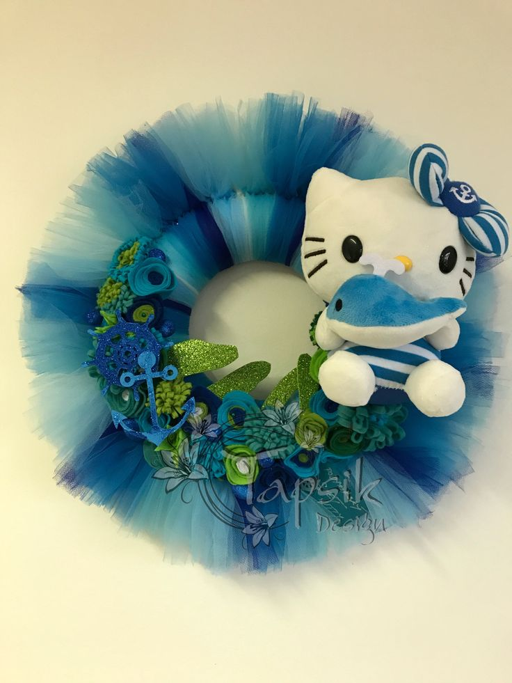Hello Kitty Wreath, Giveaway. And the second wreath from my Kitty giveaway is done as well. Sea Wolf Kitty. Base styrofoam wreath. Next added different colors of tulle. Handmade felt flowers balls, anchor, wheel and board. You can write on that board. And of course Kitty. Around 45 cm.
