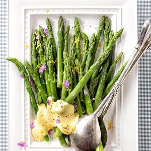 Asparagus with Lemon Sauce - We've draped tender asparagus with a velvety Meyer lemon sauce in this sophisticated spring side dish. A pinch of cayenne pepper adds spice.