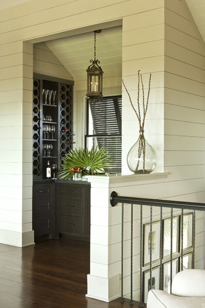 Maybe there's a way to have these fold up against the house for full sun when needed.  tropical wine cellar by Brown Contractors Fine Custom Homes