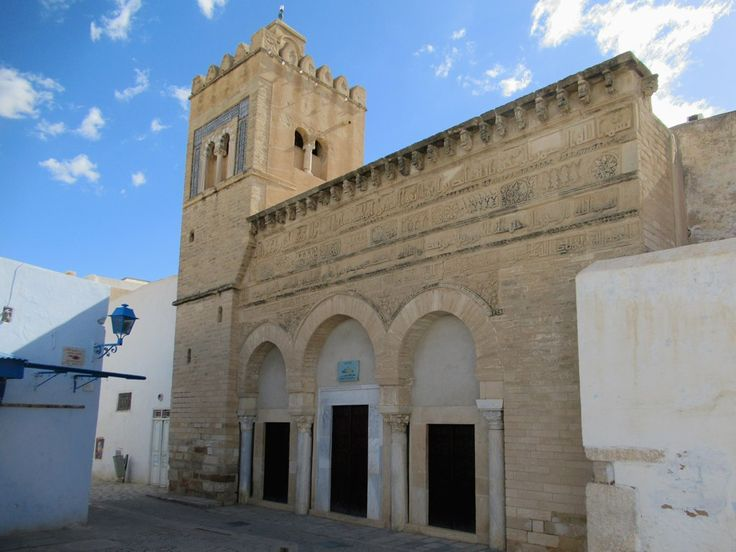 The facade of the 9th century Mosquée de Trois Portes in Kairouan, Tunisia, bears Kufic inscriptions of verses from the Quran.