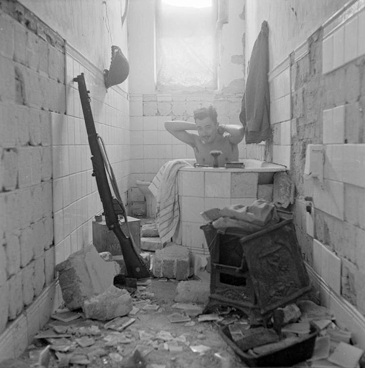 A British soldier takes advantage of the opportunity to have a bath in Tobruk. (February 17, 1942) Via the Imperial War Museum