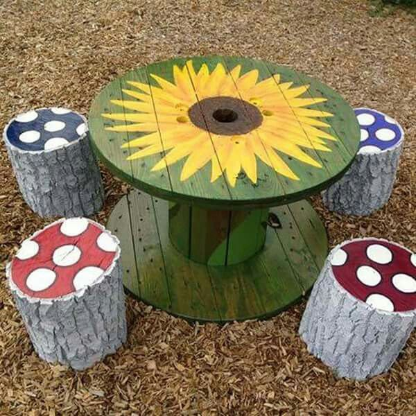Wooden cable spool as a table & tree stump stools.