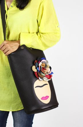 Large bucket-style leather tote bag handcrafted with superior quality, buttery soft Brown cowhide leather. Features a handmade Frida Kahlo appliqué. Face silhouette is made of natural leather...