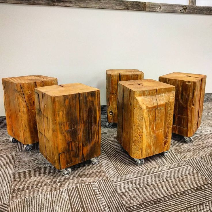 Reclaimed barn beam cubes by barnboardstore.com.  These were put on steel casters for mobility