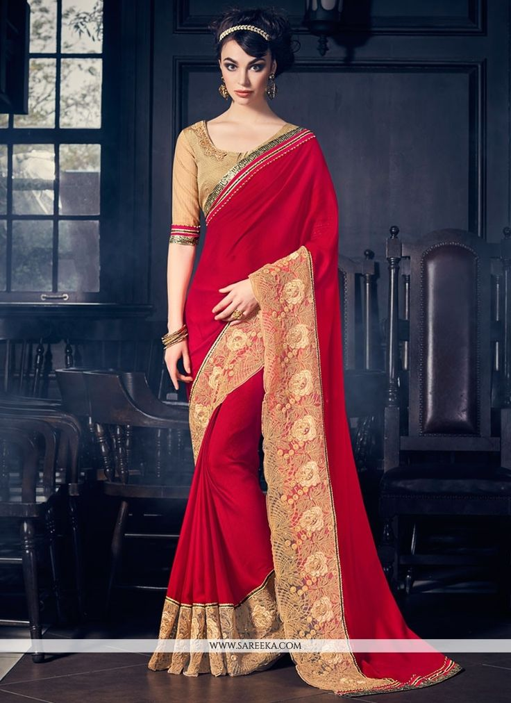 Precise attractiveness will come out through the dressing trend with this red faux georgette classic designer saree. The pretty embroidered and patch border work all through the dress is awe inspiring...