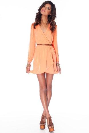 It's a wrap dress in tangerine