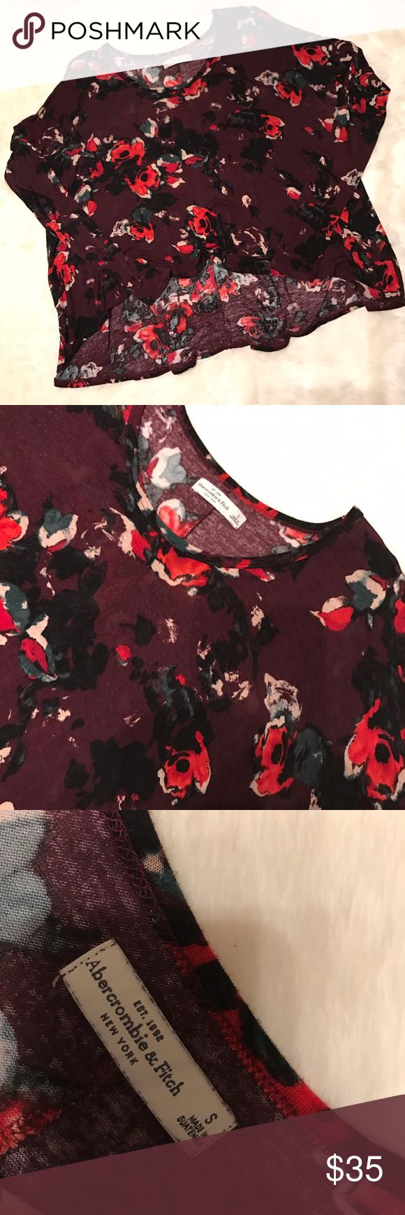 Floral Flowy High-Low Top from Abercrombie & Fitch Floral high-low style top from Abercrombie. Lays kind of weird due to it being thin, but it's super cute on. Great condition. Size small. Make an offer! Abercrombie & Fitch Tops Blouses