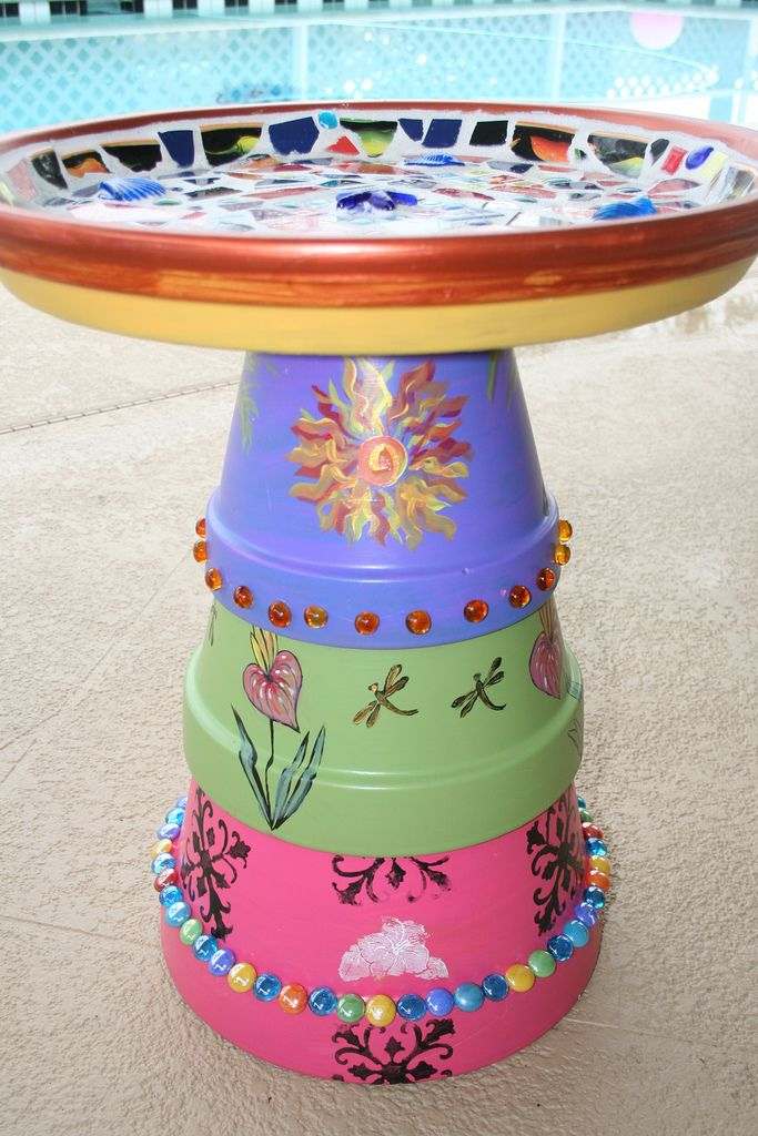Terra Cotta Pots made into birdbath with mosaic bath and painted key west style