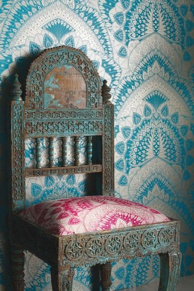 """""""I never tire of the peacock's majestic, symmetrical beauty. I wanted to capture its essence but in a fresh new way so set about a graphic repeat pattern using solid blocks of colour and treating the design as if it were a fine, intricately-woven lace."""" Matthew Williamson x Osborne & Little Azari wallpaper."""