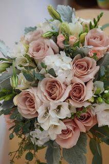 Bloom & Vine Quicksand rose, freesia, dusty miller, phlox and seeded eucalyptus bridal bouquet
