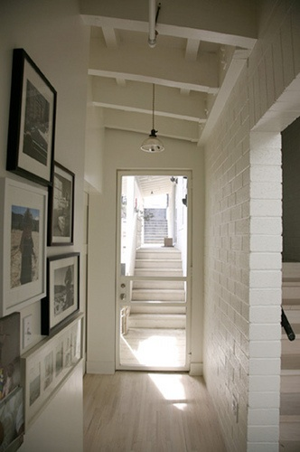 white brick white walls and wood detailed ceiling