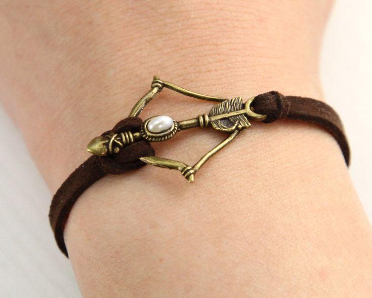 Disney Brave Inspired Merida Bow leather bracelet. $2.99, via Etsy.  Kinda steampunk to me - I like it.