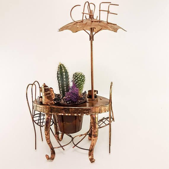 copper cafe bistro table,chairs with succulents and umbrella - decor