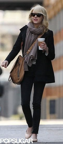 emma stone in a black/neutral outfit