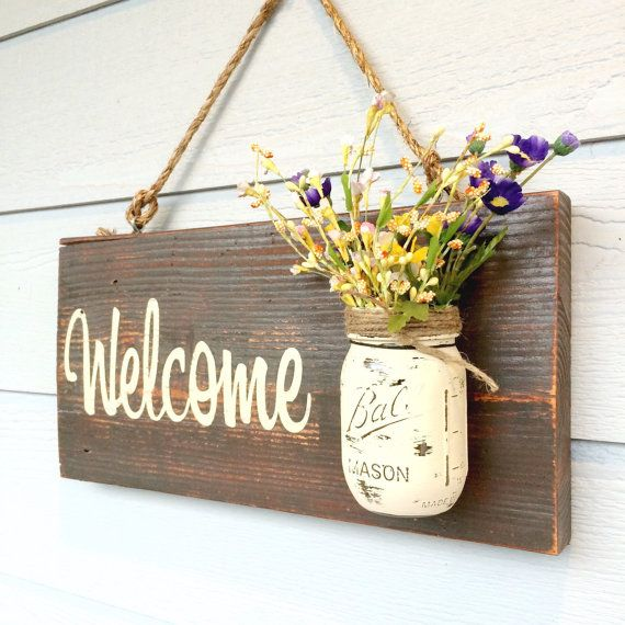 Hand painted Welcome real wood sign. Includes rope for hanging and the Mason jar…